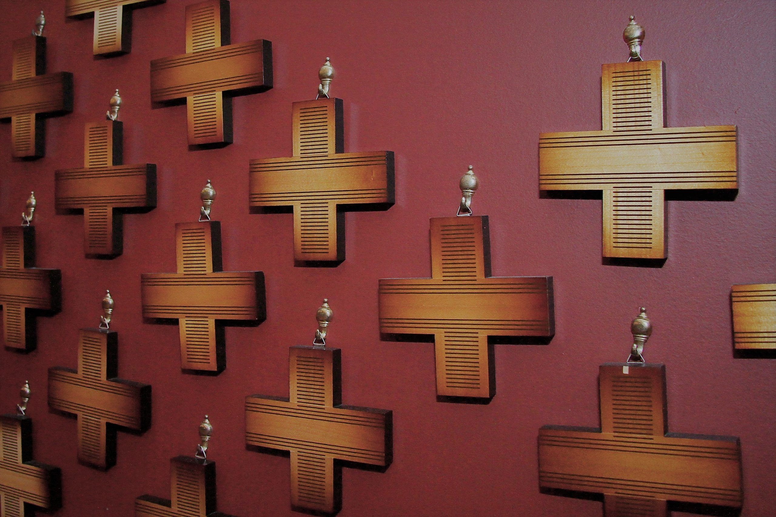 Wooden memorial crosses hanging in the church.