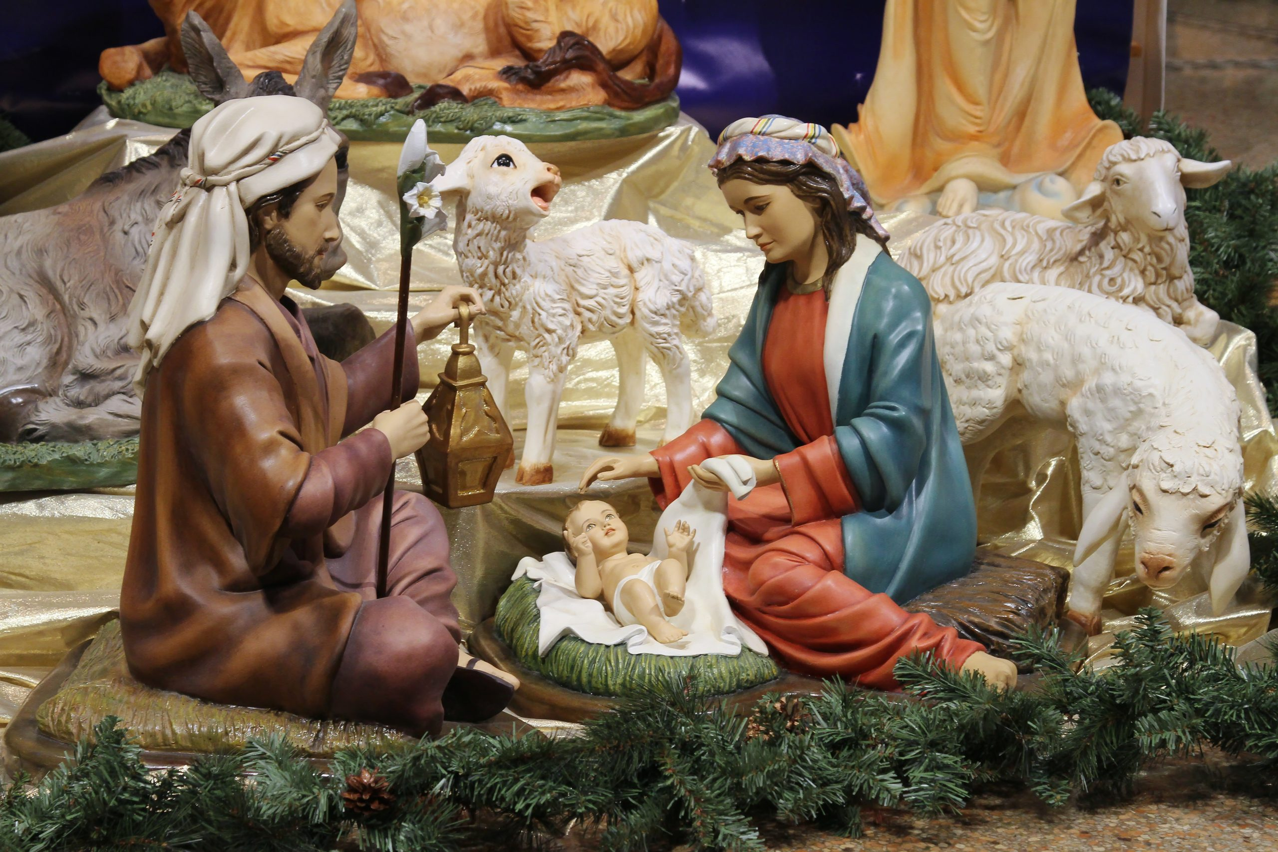 Close up of Jesus, Mary and Joseph from the nativity scene in front of the altar.