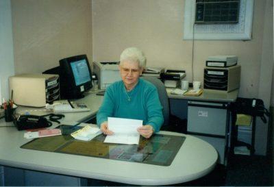Barbara Dubosky working at a desk.